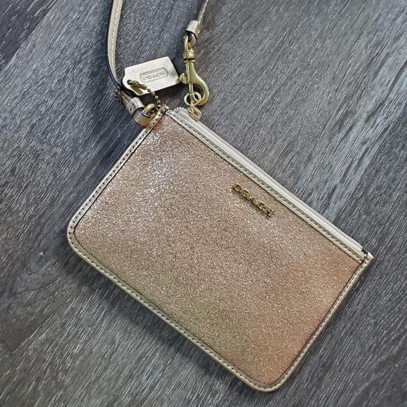 Coach Handbags - Gold glitter Coach wristlet